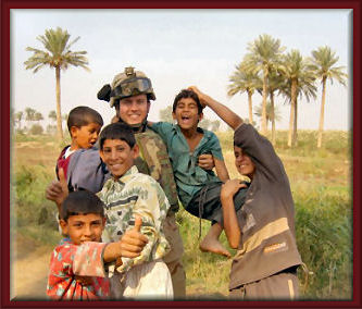 Mark Bryant with local kids in Iraq: courtesy of Michelle Bryant
